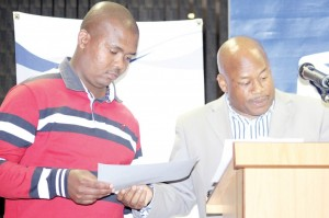 Lesotho-Times-Senior-Sports-Reporter-Mikia-Kalati-left-recieves-an-award-from-MISA-Lesotho-Director-Tsebo-Matšasa-1024x682