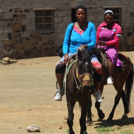 Marenang Ntlheng, in front and Maatang Moseli arriving at Ha-Mokoto Clinic in the Thaba Tseka District