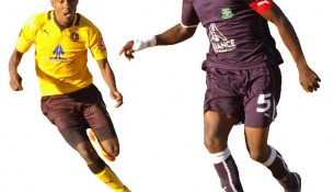 LCS Skipper Moitheri Ntobo controll the ball as Bantu wiger Mokone Marabe close in