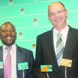 FNBL Head of Risk, Sekete Phohlo (left) and  FNBL COO Gary Chapman holding the new cards during the launch ceremony on Tuesday. (2)