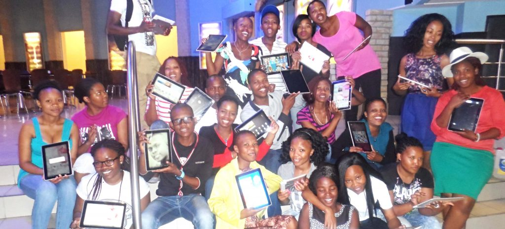 MOS TECH students hold the tablets they received from Vodacom on Tuesday.