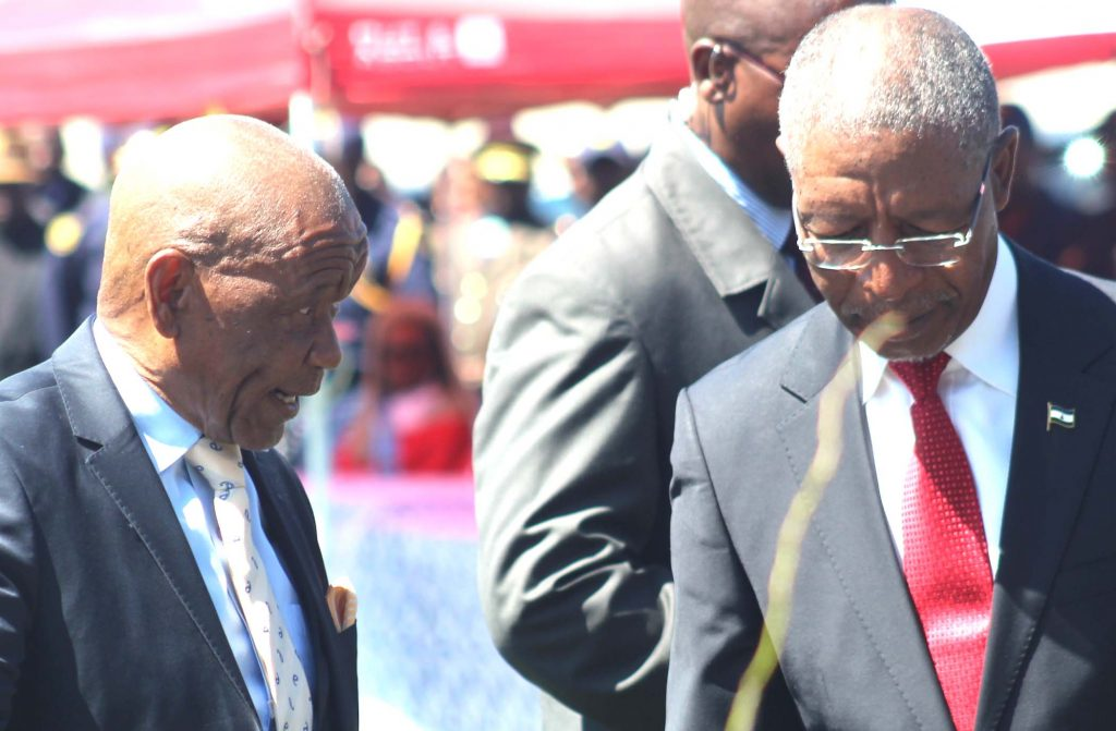 Outgoing Prime Min Thom Thabane, left, chats with the incoming PM Pakalitha Mosisili after hading over power on at Setsoto Stadium on  Tuesday