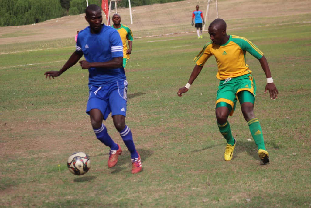 "Newly signed Bantu midfielder Fidel ""Maestro"" Ntoya ,left, in  blue jersey"