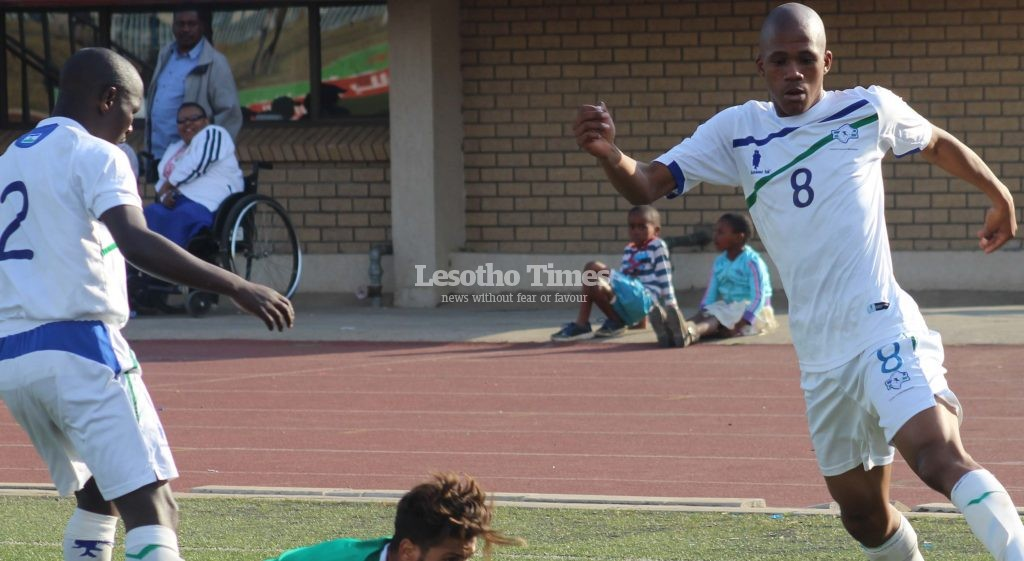 Likuena striker Tšepo Seturumane (right) controls the ball during Sunday's AFCON qualifier at Setsoto stadium.