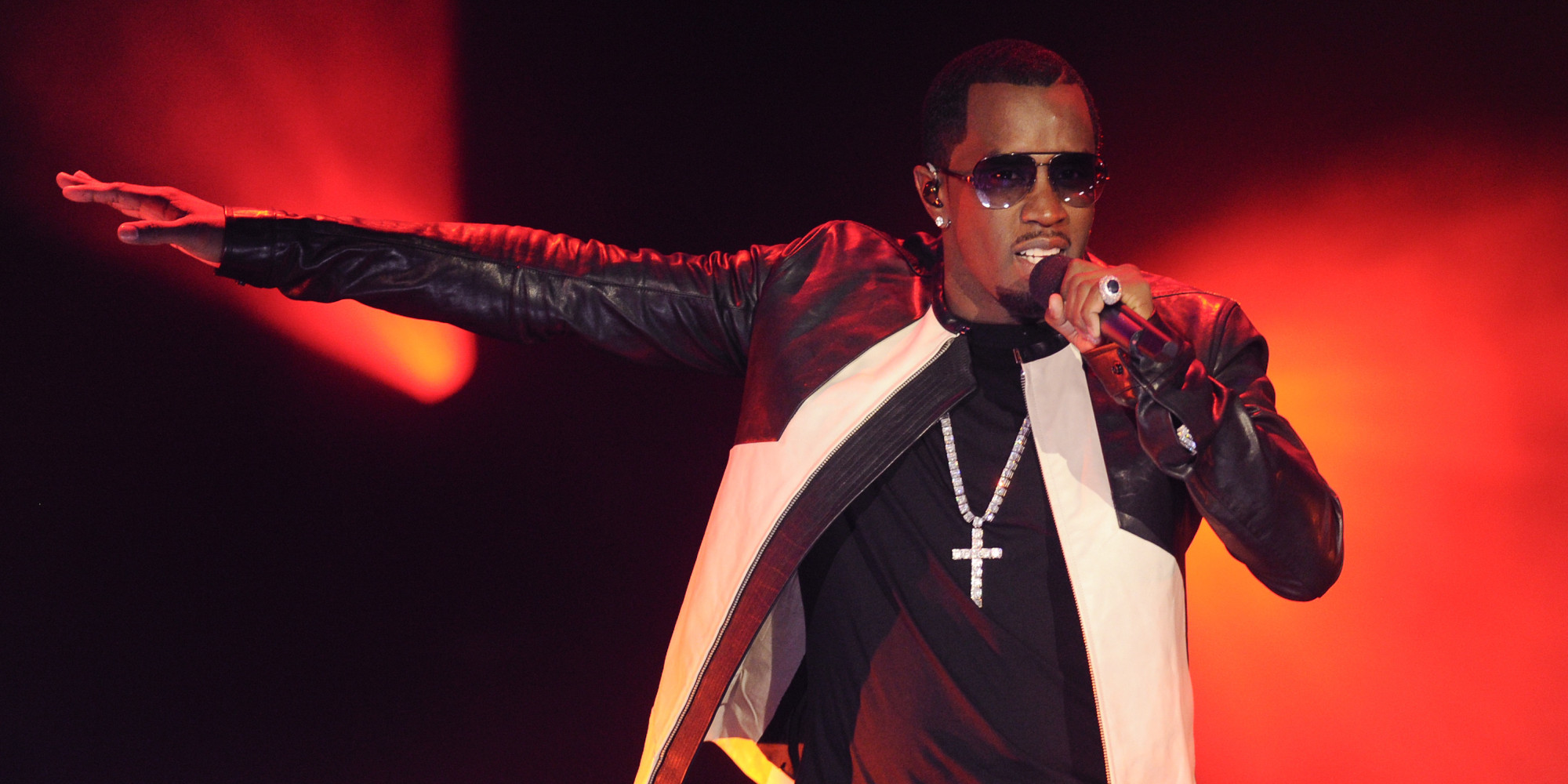 """Hip-hop entrepreneur Sean """"P. Diddy"""" Combs performs at Caesars Entertainment """"Escape to Total Rewards"""" kick-off at Gotham Hall on Thursday, March 1, 2012 in New York. (AP Photo/Evan Agostini)"""