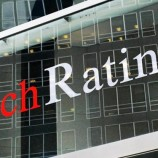 Fitch warns of dark clouds ahead
