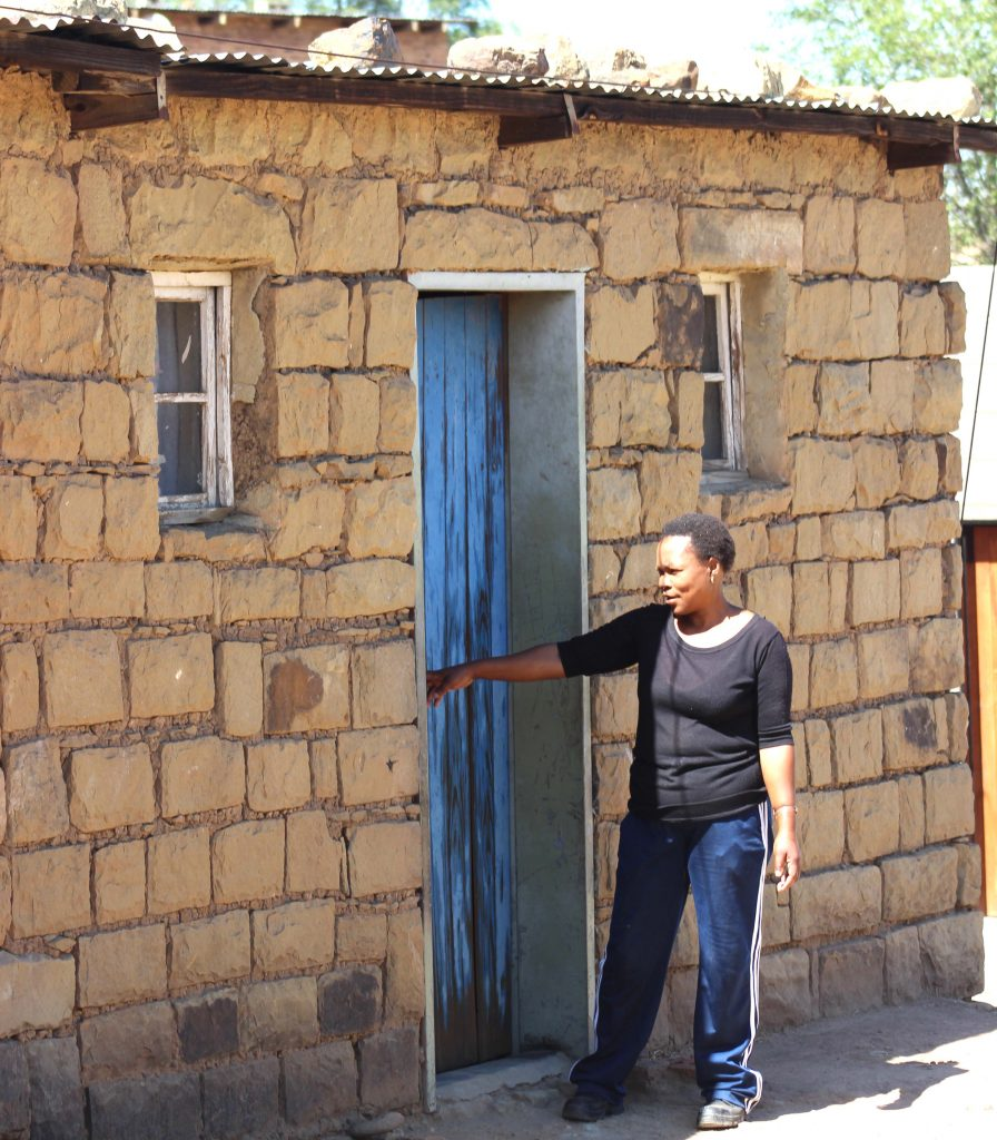 'Maneo Nthunya shows the Lesotho Times crew the room which Ntahli Chuene rented