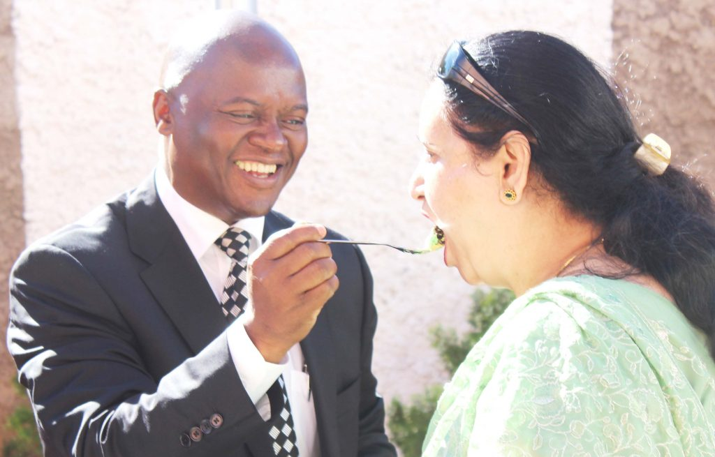 Mr Sekhamane shares the cake with Mrs Bakaya