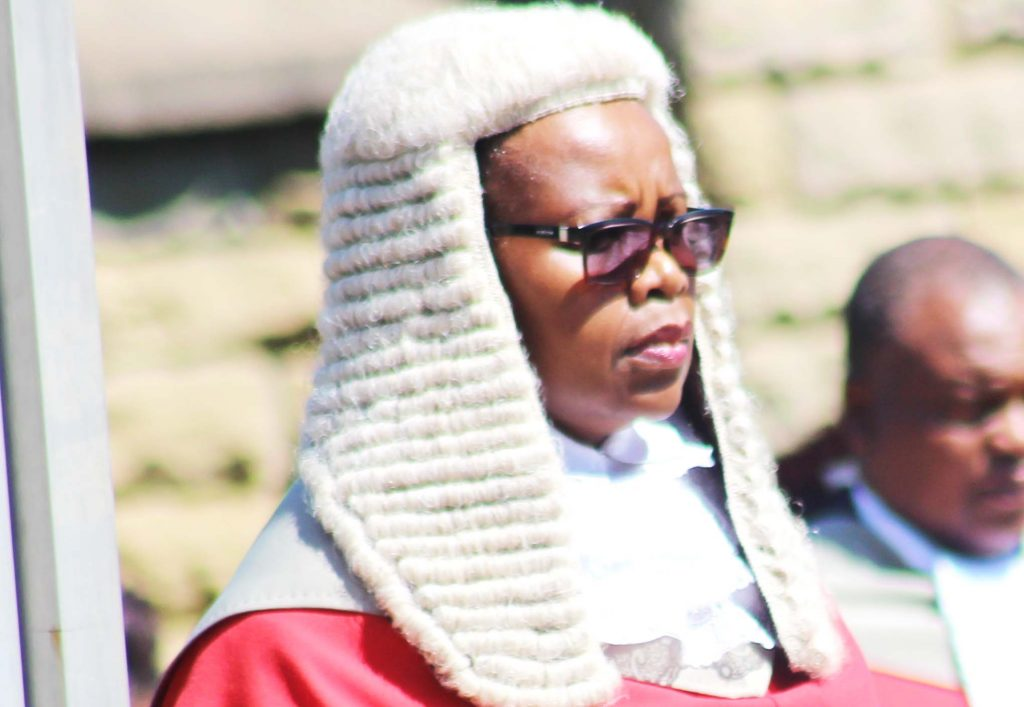 Her Lordship Chief Justice Nthomeng Majara inpects the guard of Hounor on Monday during the opening of the High Court