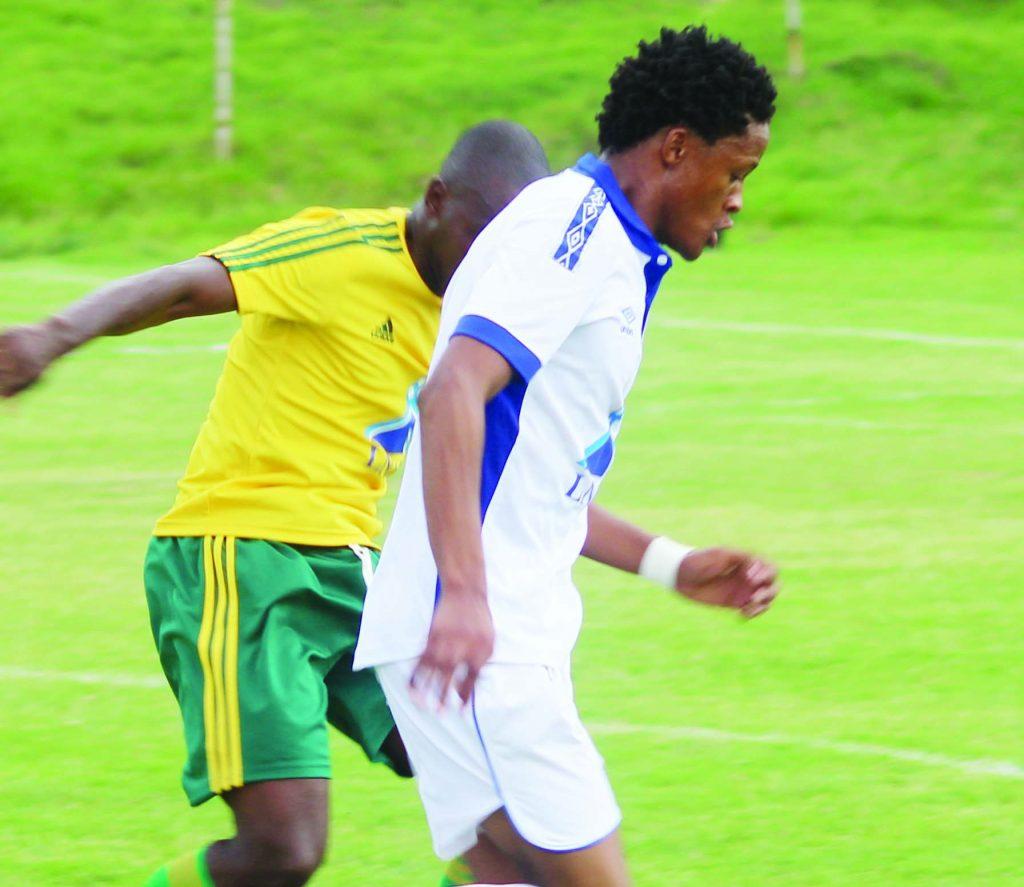 Matlama striker Motebang Sera (in front) closely wathced by LDf defender Koporale Motanyane in LNIG Top8 quarterfinal played at LCS yesterday (1)