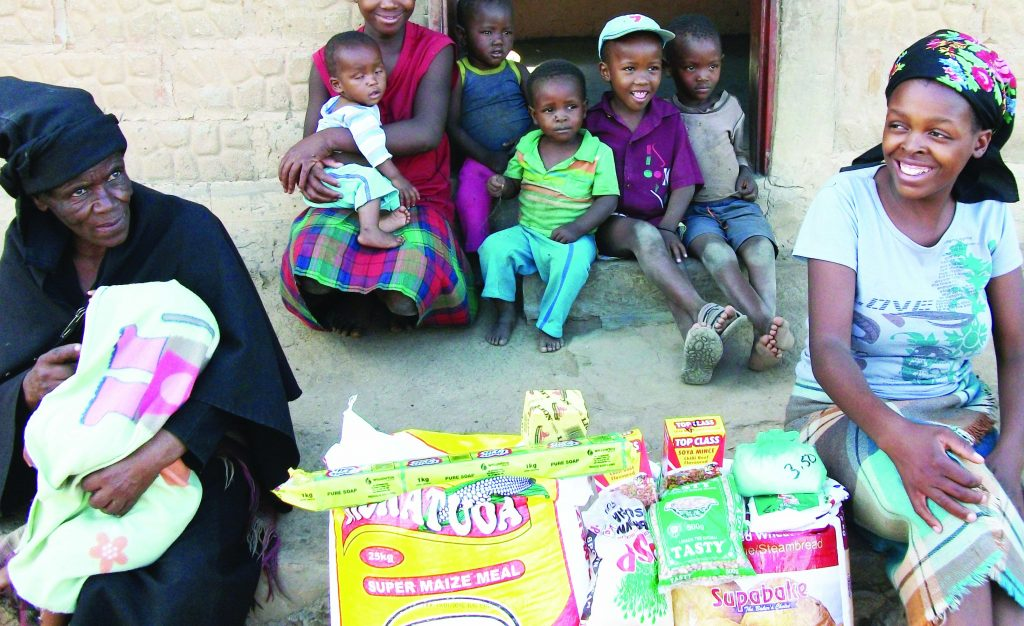 'Manthabiseng Moletsane (in black) and her family after receiving help from WFP