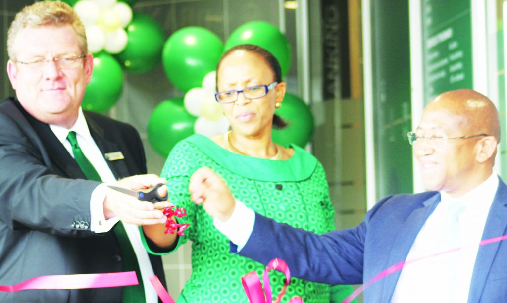 FROM left Nedbank Lesotho MD PJ Bouwer, CBL Governor Dr Retšelisitsoe Matlanyane and Accountant-General Sam Mphaka cut the ribbon to officially open the TY branch