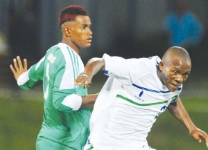 MAFA Moremoholo of Lesotho, right, is fouled by Islahi Mmadi of Comores during the Cosafa Under-20 Youth Championship tie in Group A game between Lesotho and Comoros at Setsoto Stadium on Tuesday
