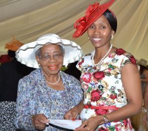 Queen Masenate Mohato Seeiso with a member of the Maseru Women Senior Citizens Association 'Malebona Lebona.