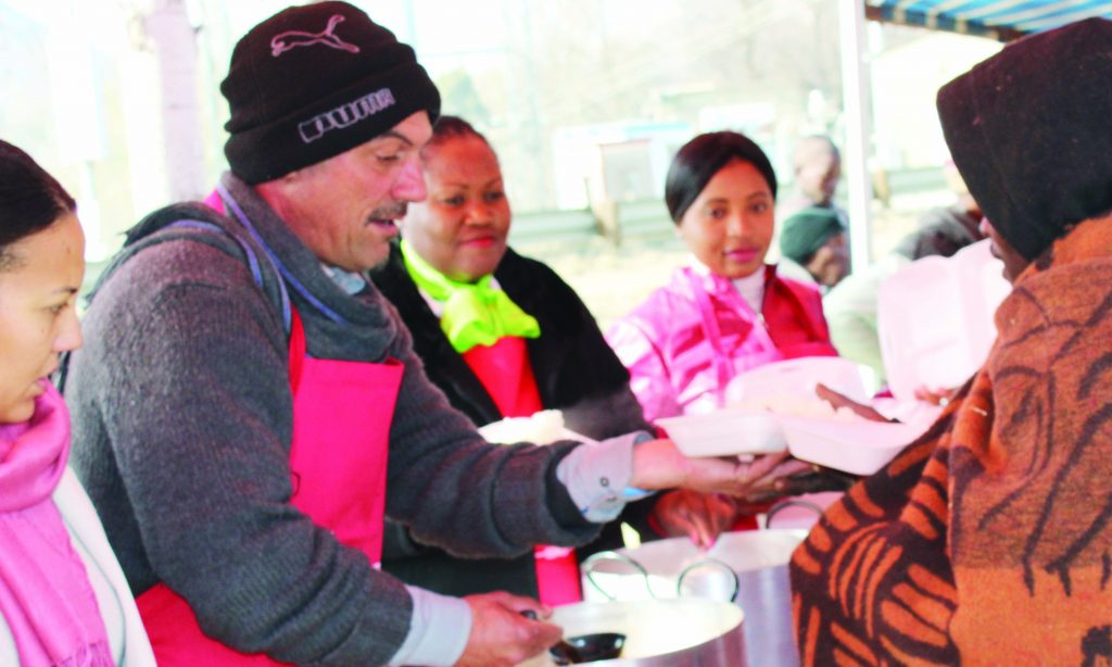 DOUGIES Kitchen's Douglas Muller dishes food to some of the vulnerable members of the community in Maseru on Tuesday.