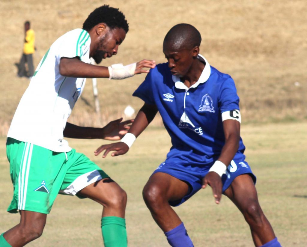 Linare striker Ts'iu Moroosi,left, tussle for the ball with Matlama midfielder Phafa Ts'osane last season during VCL Premier Leaque tie