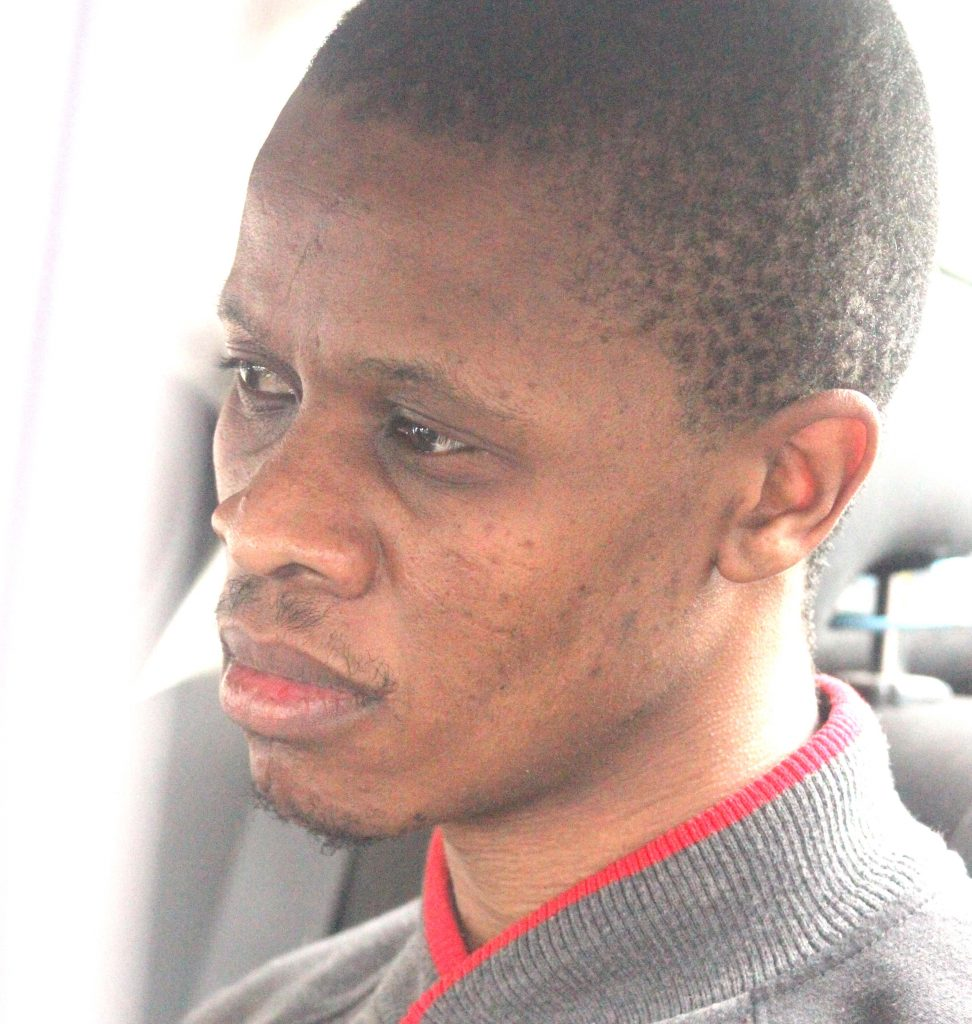 Double ritual murder suspect Lehlohonolo Scott was extradited from South Africa midmorning yesterday amid tight security