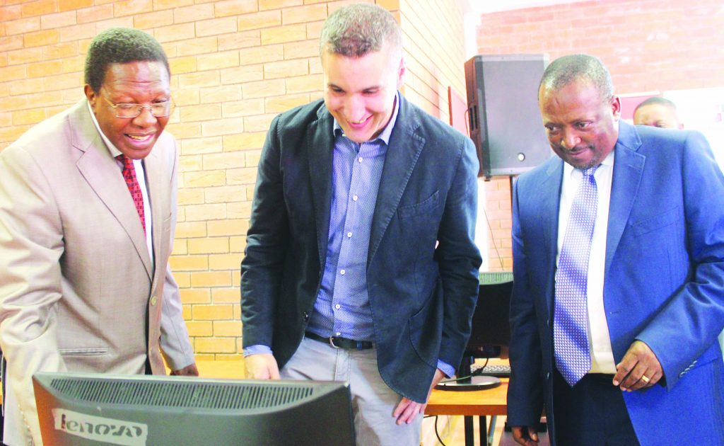 NUL Vice Chancellor Prof. Nqosa Mahao, VCL Acting MD Johnny Dos Santos, Minister Of Communications Khotso Letsatsi.