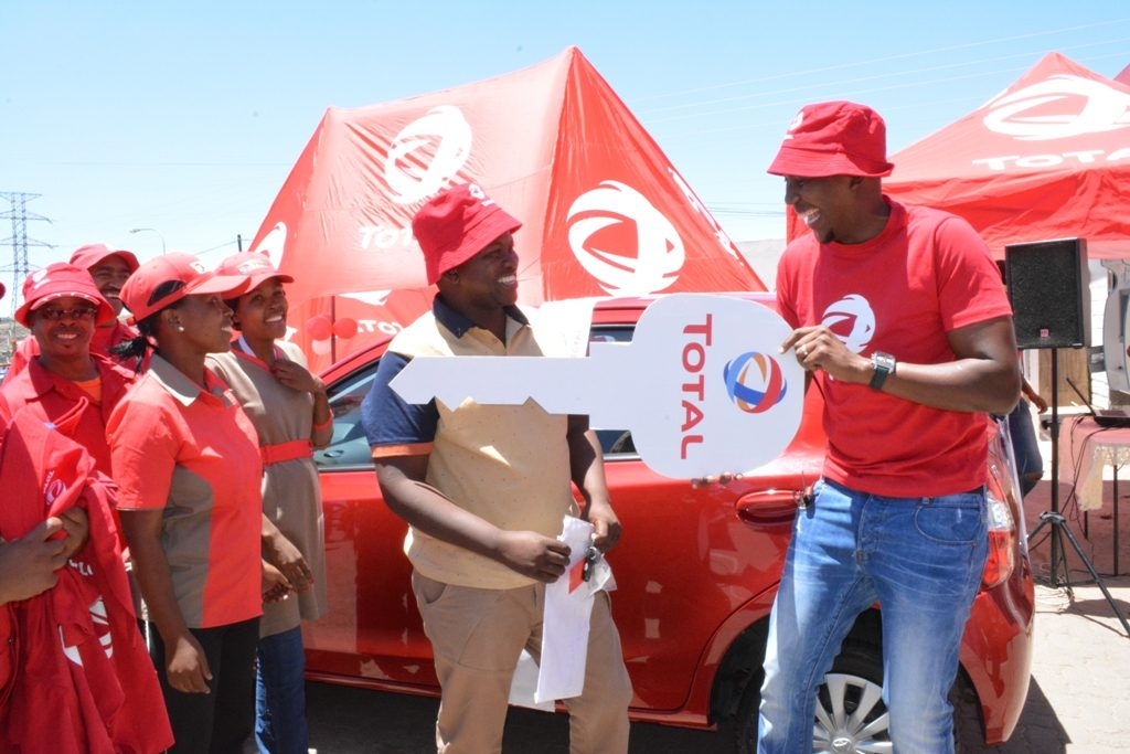 TL Territory Manager Letele (right) presents the Toyota Etios to Qhoko Masokela in Masianokeng on Saturday (3)