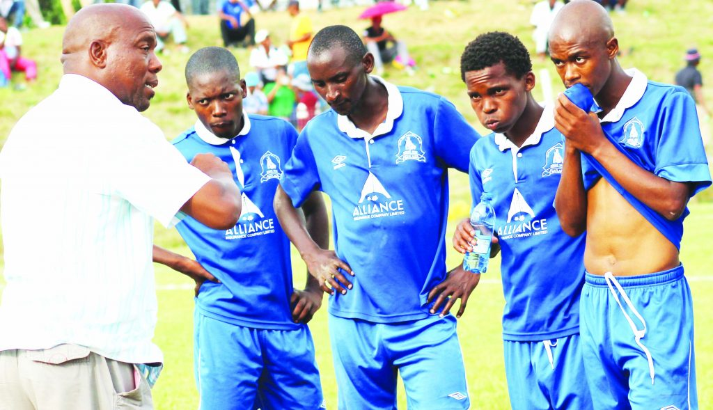 Matlama coach, Moses Maliehe ( in a shirt) gives instructions to his players during one of the league matches at LCS Ground,
